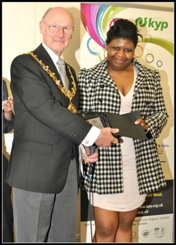 Joyce Osadolor receives the Outstanding Achiever Award from the Mayor of Rochdale