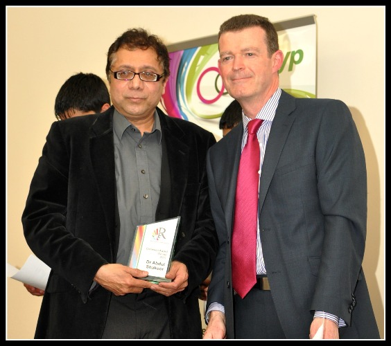 Dr Abdul Shakoor receives the Cohesion award from Jim Taylor