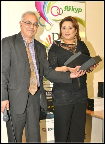 Salma Chaudri receives the Female Ethnic Minority Achiever award from Ali Asghar