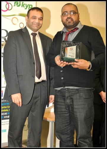 Mohammed Sheraz receives the Volunteering award from Shoab Akhtar