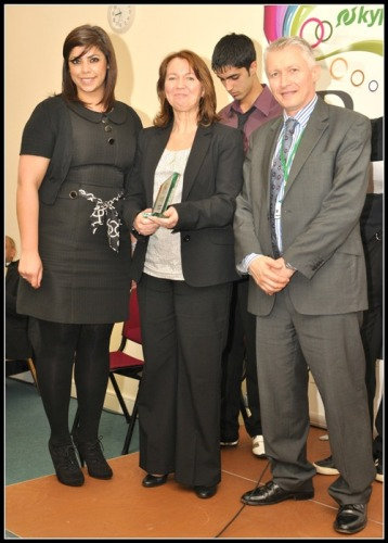Rochdale Training Association receives the Apprenticeships award from John Spindler