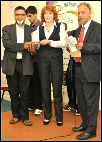 Rochdale MIND receives the Health award from Daalat Ali