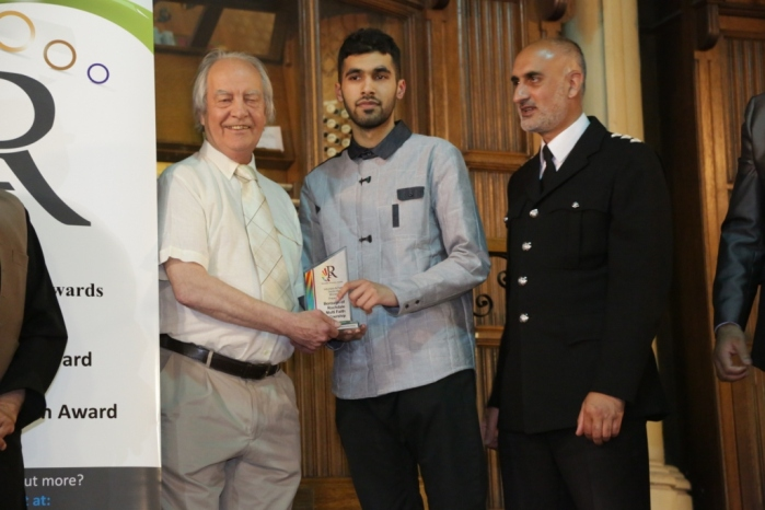Voluntary & Faith Sector Award - Winner Borough of Rochdale Multifaith Partnership - Robin Parker and a Partnership member with Inspector Nadeem Mir of GM Police
