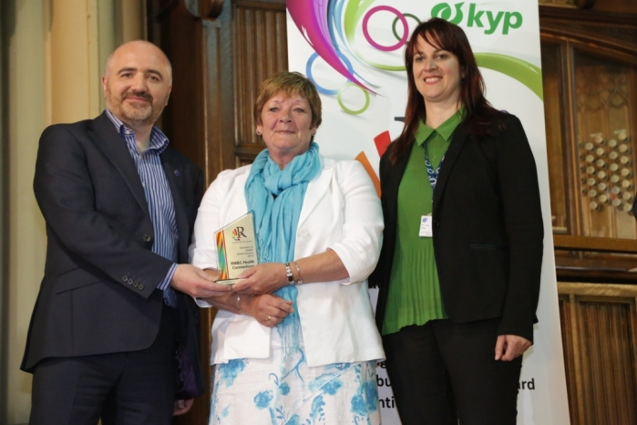 Diversity in Health Award - Winner Rochdale Council Health Connections Team - Geraldine Meagher and Linda Fisher (RMBC Deputy Chief Exec) receive the award from Pennine Acute NHS Hospital Trust